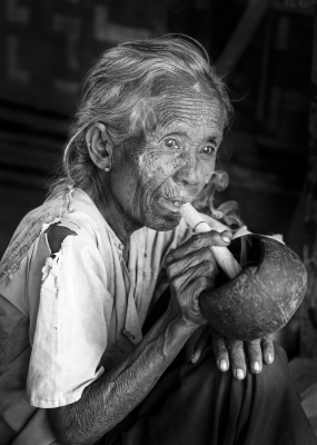 Old Woman Smoking Cheroot