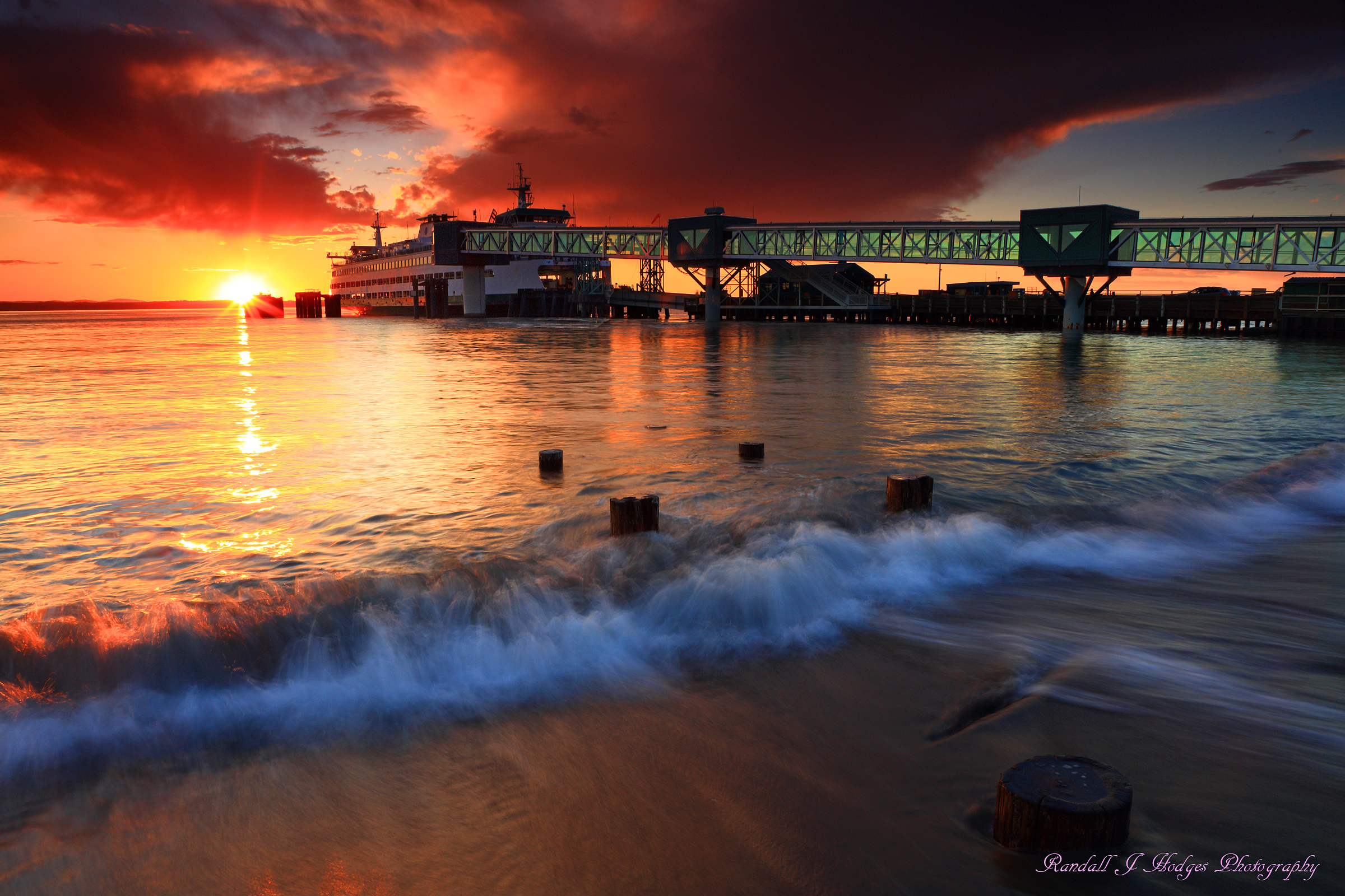 Sunset Edmonds Ferry at Dock with Wave From Brackett's Landing at Edmonds Beach in Edmonds Washington