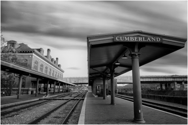 Black and White Photo of a Train Station