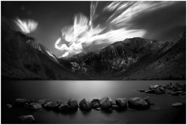 Black and White Photo of a Lake and Mountain