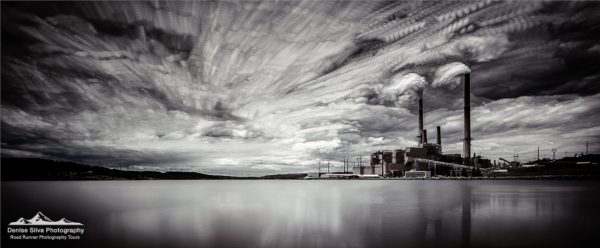 Black and White Photo of a Power Plant with a Lake in the Foreground
