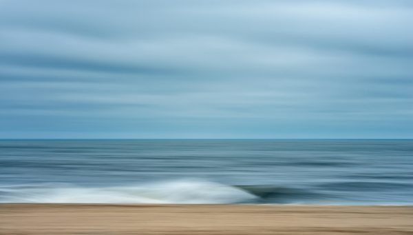Photo of a beach with calm waves