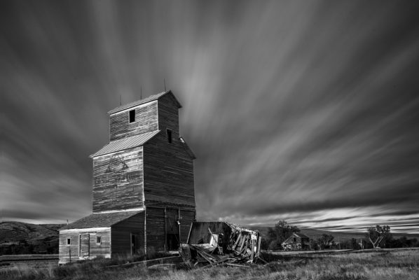 Black and White Photo of a Barn and cloudy sky